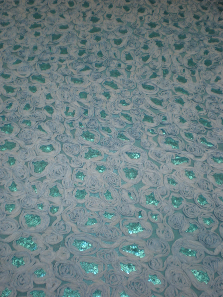 fabric with blue flowers and sequins - Fabric Universe