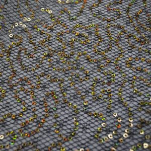 Gold sequins on black spider mesh fabric - Fabric Universe