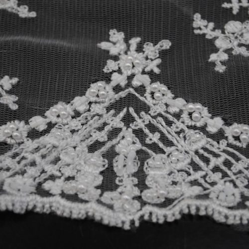 White bridal lace fabric with hand sewn beads