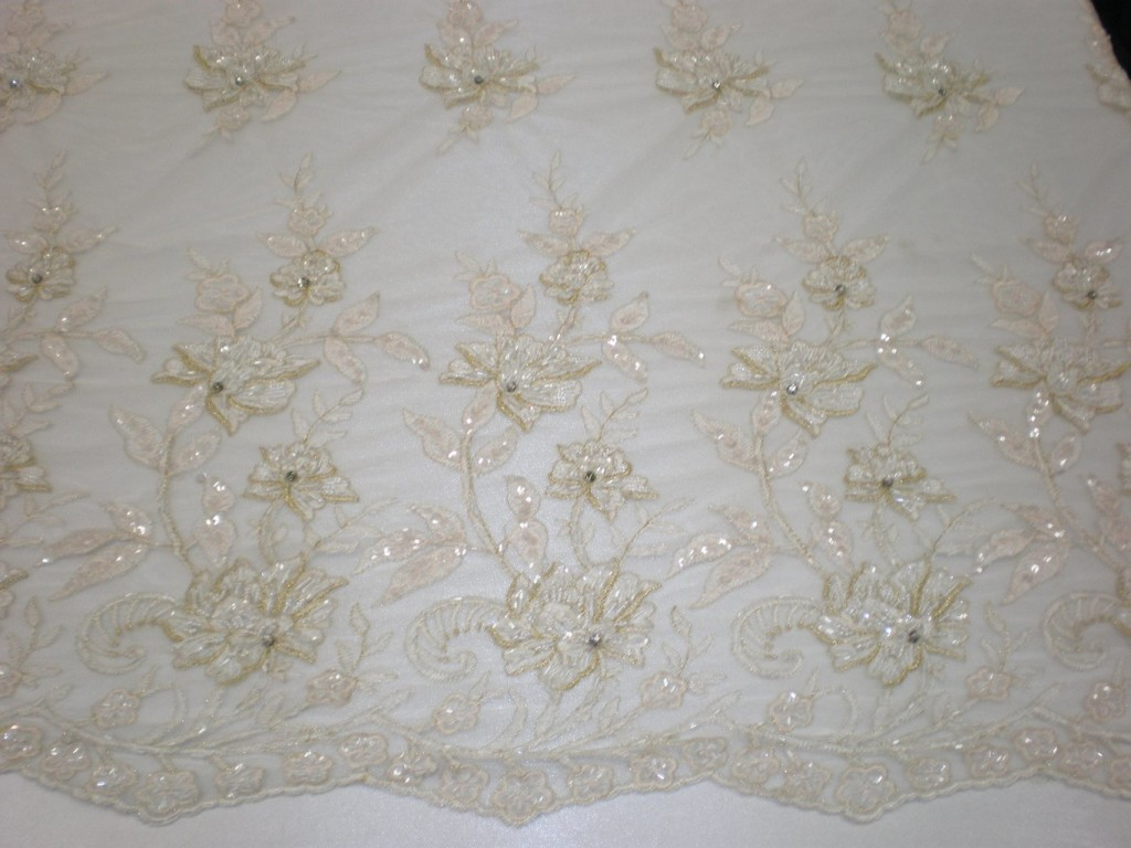 White embroidered mesh with hand sewn beads