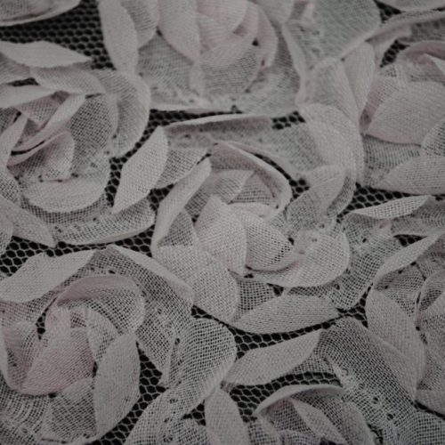 Pink baby flowers on mesh ground fabric - Fabric Universe