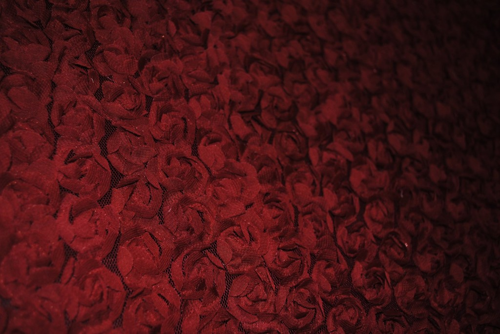 Red baby flowers on mesh ground fabric - Fabric Universe