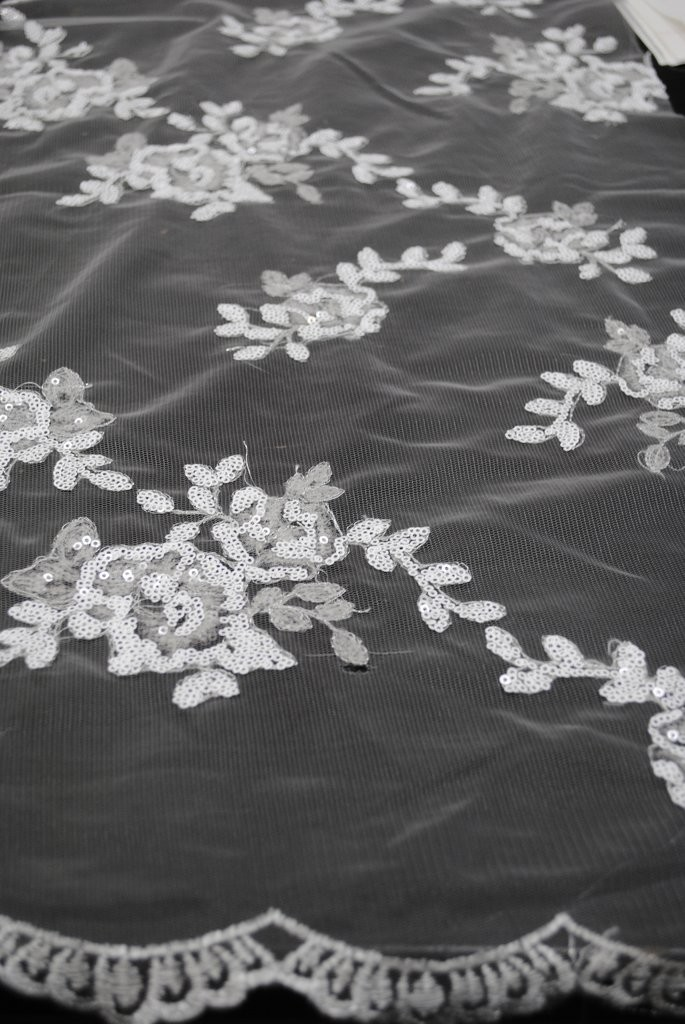 White Flowers Made of Sequins on Mesh