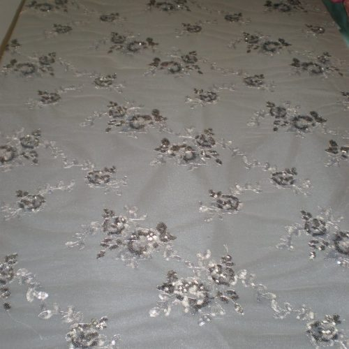 Silver Flowers Made of Sequins on Mesh by Fabric Universe